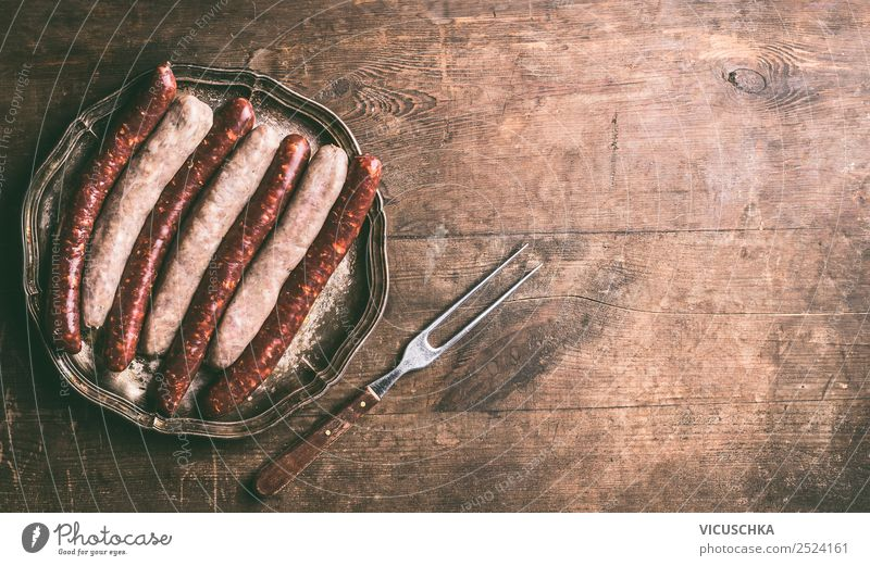 Fried sausages with meat fork Food Sausage Nutrition Crockery Design Table Barbecue (apparatus) Style Background picture Bratwurst Selection Fork Wooden table