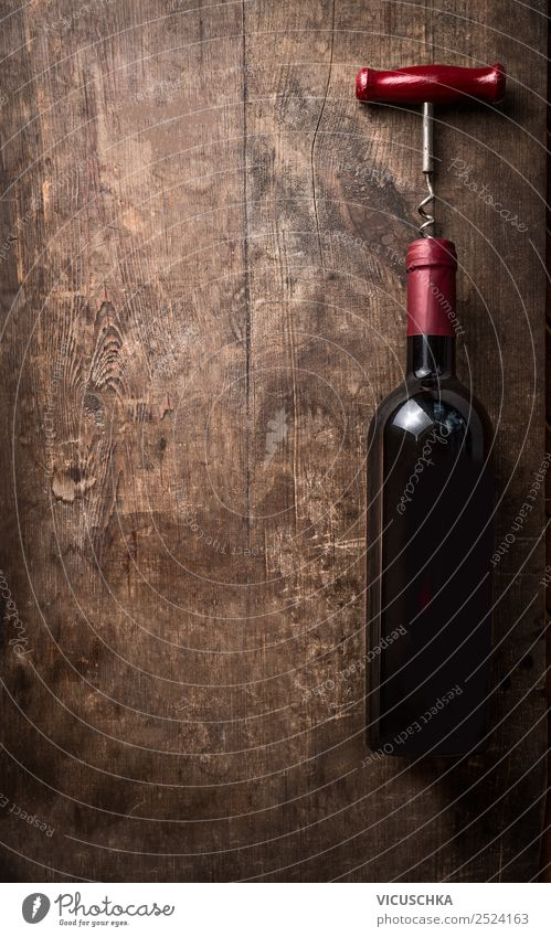 Red wine bottle with corkscrew on wooden background Beverage Alcoholic drinks Wine Shopping Style Design Party Event Restaurant Bar Cocktail bar Business