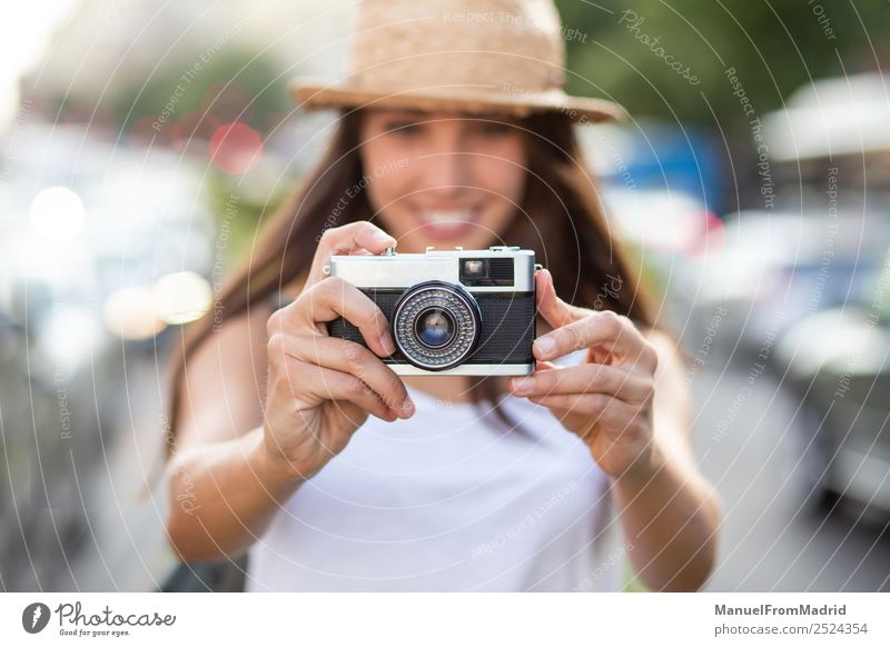 attractive young woman taking pictures outdoors Lifestyle Joy Beautiful Leisure and hobbies Vacation & Travel Summer Camera Technology Woman Adults Street