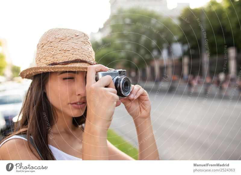 attractive young woman taking pictures outdoors Style Joy Beautiful Leisure and hobbies Vacation & Travel Summer Camera Technology Woman Adults Street Fashion