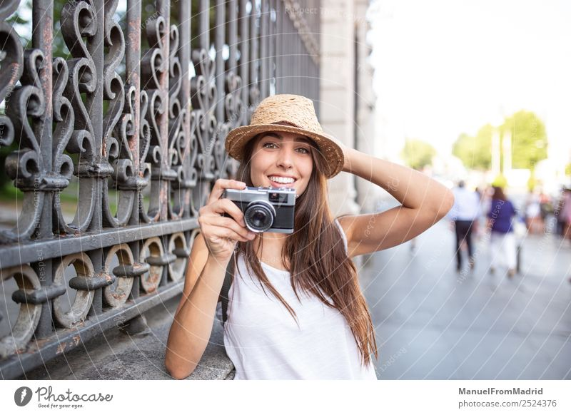 attractive young woman taking pictures outdoors Lifestyle Style Joy Beautiful Leisure and hobbies Vacation & Travel Summer Camera Technology Woman Adults Street