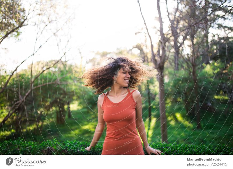cheerful black afro woman outdoors Lifestyle Joy Happy Beautiful Face Leisure and hobbies Freedom Summer Sun Human being Woman Adults Nature Tree Grass Park