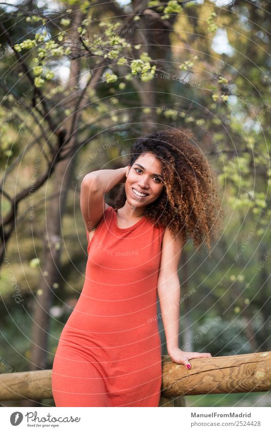 cheerful black afro woman outdoors Lifestyle Joy Happy Beautiful Face Leisure and hobbies Freedom Summer Sun Camera Human being Woman Adults Nature Tree Grass