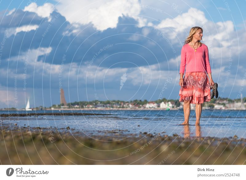 Woman standing in the Kieler Förde with view to the side Vacation & Travel Tourism Far-off places Summer Summer vacation Beach Ocean Human being Feminine Adults