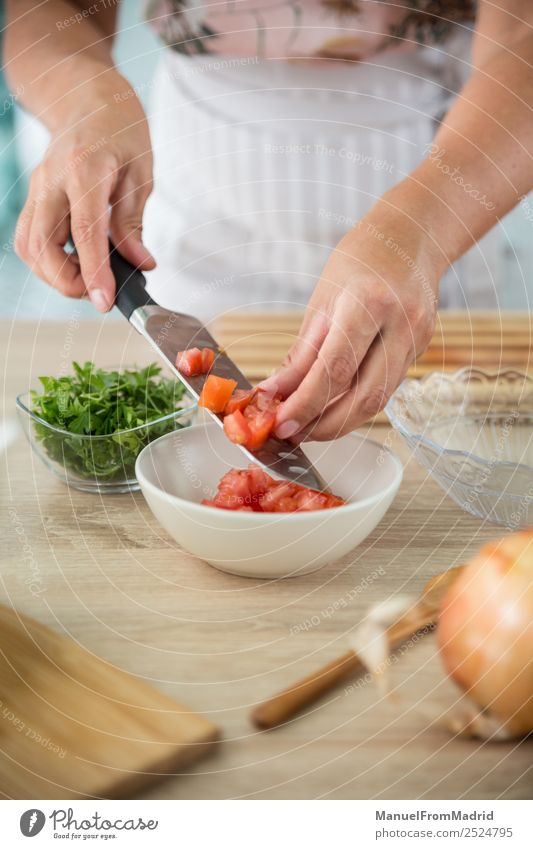 woman preparing a gazpacho Vegetable Soup Stew Herbs and spices Dinner Vegetarian diet Diet Bowl Table Kitchen Woman Adults Hand Fresh Green Tradition cold