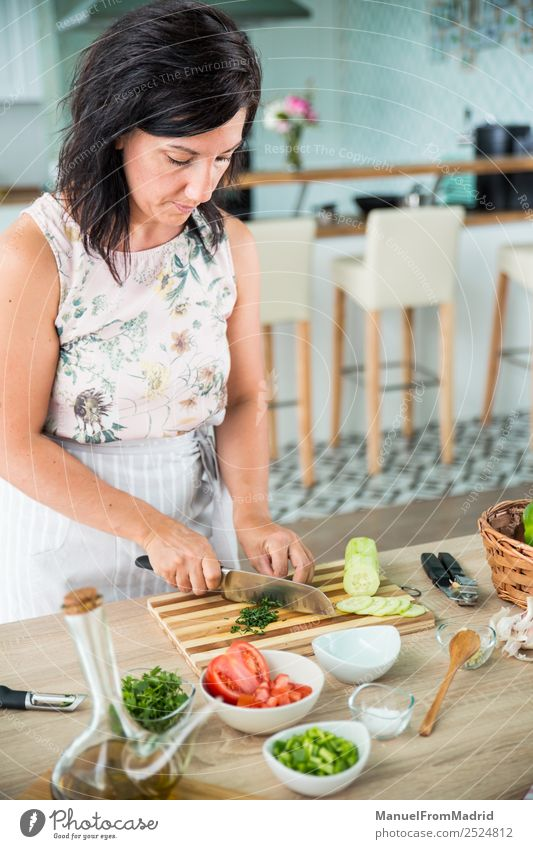 woman preparing a gazpacho Vegetable Soup Stew Herbs and spices Dinner Vegetarian diet Diet Bowl Table Kitchen Woman Adults Hand Fresh Green Tradition cold cook