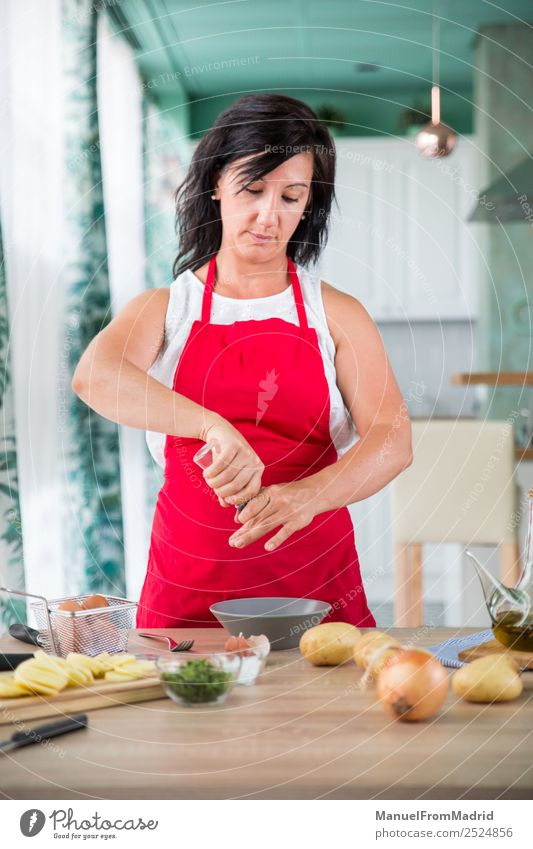 woman chef preparing a recipe Nutrition Plate Table Kitchen Human being Woman Adults Hand Wood Modern cook spanish Omelette egg potatos onions food cooking Dish