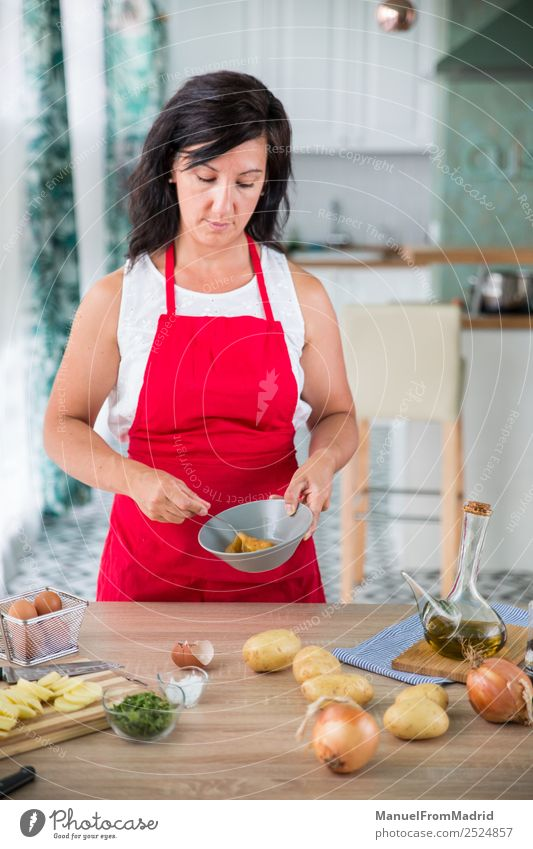 woman chef preparing a recipe Nutrition Plate Table Kitchen Human being Woman Adults Hand Wood Modern cook spanish Omelette whipping egg potatos onions food