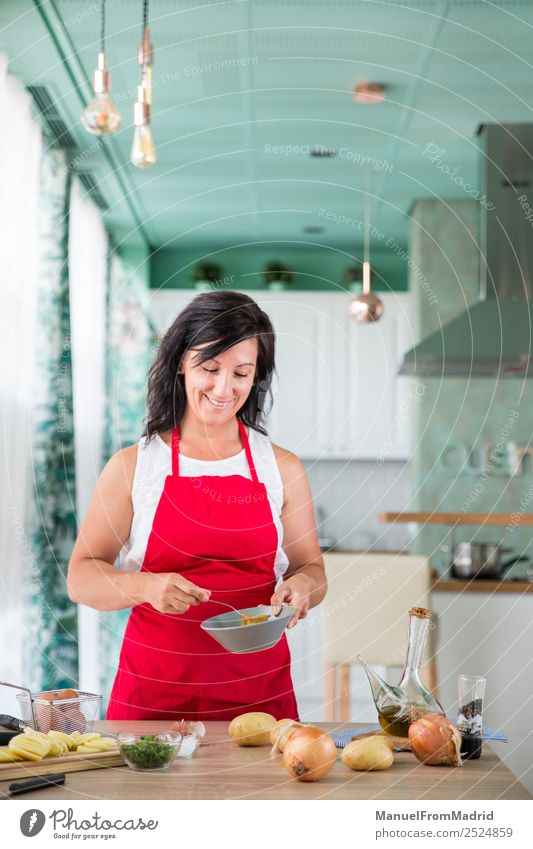 woman chef preparing a recipe Nutrition Plate Happy Table Kitchen Human being Woman Adults Hand Wood Smiling Modern cook spanish Omelette egg potatos onions