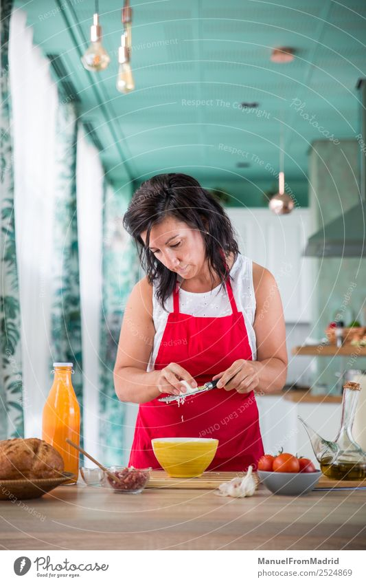 woman chef preparing a recipe Nutrition Plate Table Kitchen Human being Woman Adults Hand Wood Modern cook Grating Hard-boiled egg food grater salmorejo cooking