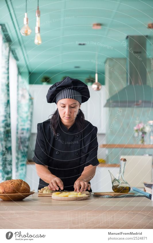 woman chef preparing a recipe Nutrition Plate Table Kitchen Human being Woman Adults Hand Wood Touch Modern Concentrate cook potatos Potatoes food cooking Dish