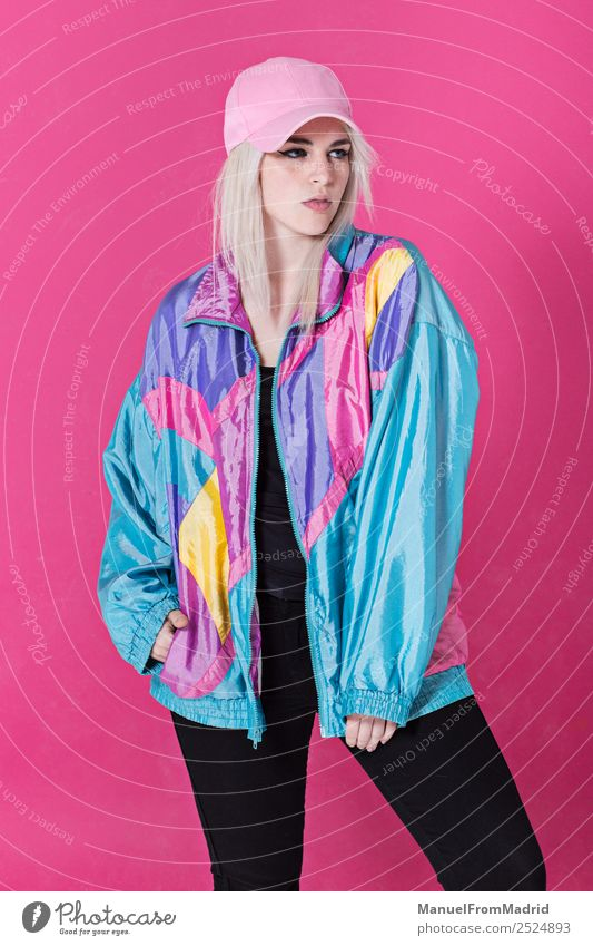 Stylish young woman posing Lifestyle Style Beautiful Make-up Woman Adults Fashion Clothing Retro Crazy Cool (slang) Esthetic Kitsch 80s pink background swag