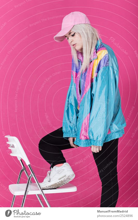 Stylish young woman posing Lifestyle Style Beautiful Make-up Chair Woman Adults Fashion Clothing Retro Crazy Cool (slang) 80s pink background swag Lean teenager