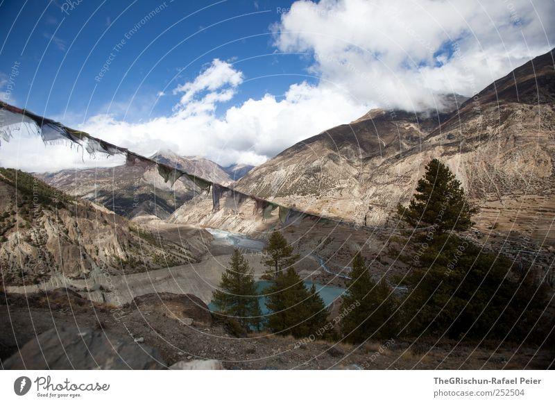 Sky Nature Tree Vacation & Travel Clouds Environment Mountain Stone Lake Horizon Rock Hiking Peak Nepal Himalayas Prayer flags