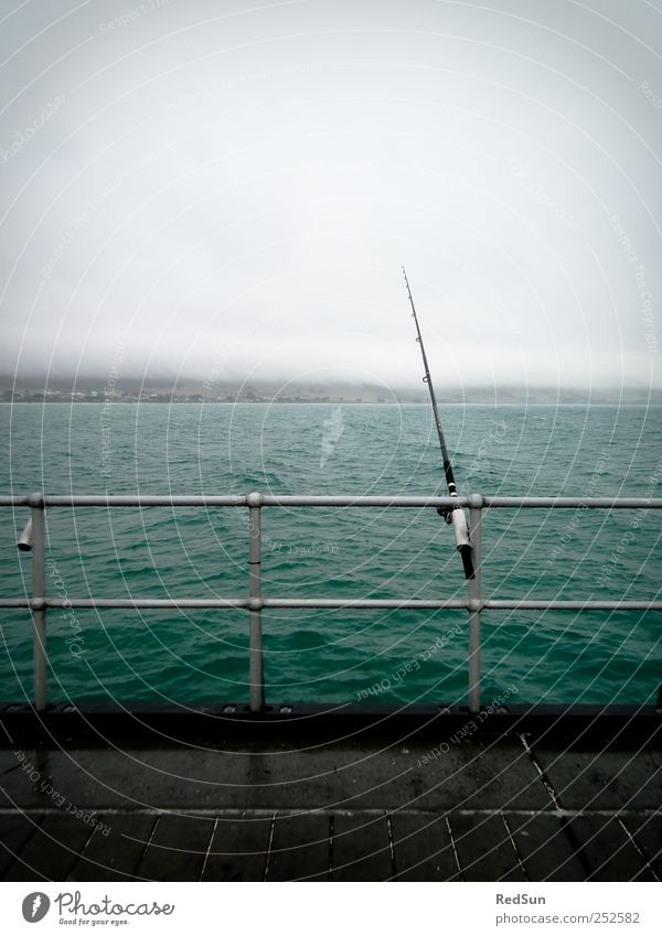 Shut up and FISH! Fishing (Angle) Trip Fishing rod Water Bad weather Coast Ocean Relaxation Dark Blue Calm Fishery Handrail Wait waiting Colour photo