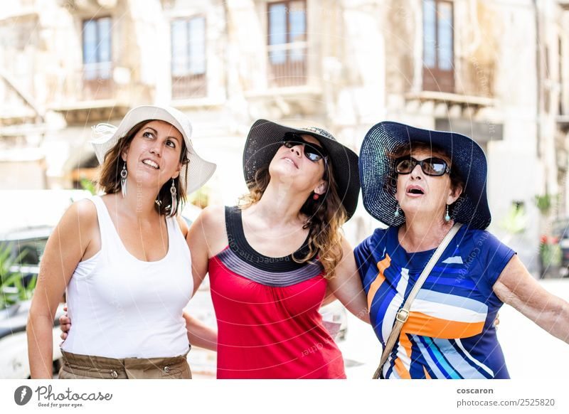 Three women looking up on the street Joy Happy Garden Human being Woman Adults Mother Grandmother Family & Relations Friendship Youth (Young adults) Group