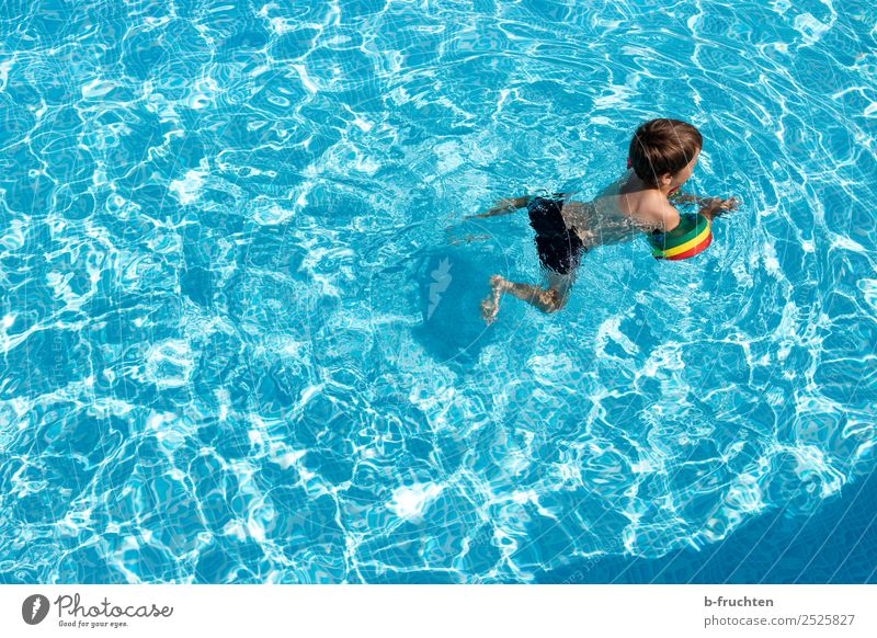 Child with swimming hoop in pool Life Swimming pool Swimming & Bathing Leisure and hobbies Vacation & Travel Freedom Summer Water Study Fresh Healthy Blue