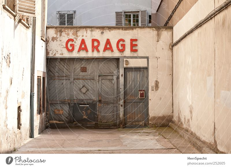 garage Downtown House (Residential Structure) Building Wall (barrier) Wall (building) Facade Characters Old Authentic Town Brown Gray Red Garage Garage door