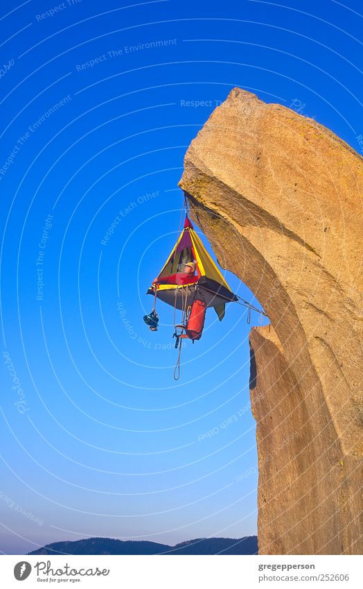 Climber and his camp dangling from a cliff. Human being Man Adults Sports Life Success Trust Brave Camping Balance Hang Attempt Willpower Self-confident Vacation & Travel Extreme