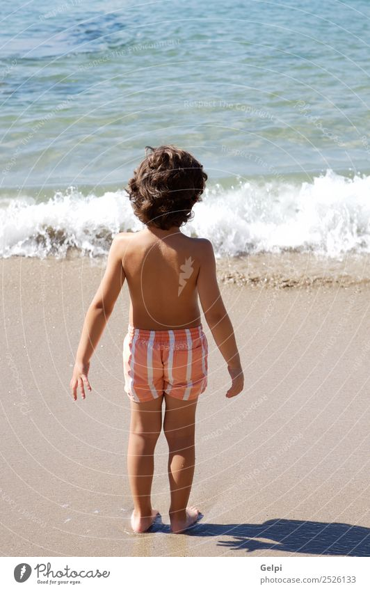adorable boy playing in the beach over a white background Joy Happy Beautiful Swimming pool Playing Vacation & Travel Trip Summer Sun Beach Ocean Child