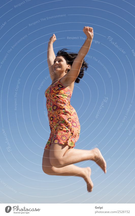 Beautiful girl jumping a over sky background Joy Happy Face Leisure and hobbies Vacation & Travel Dance Sports Success Human being Woman Adults Arm Hand Feet