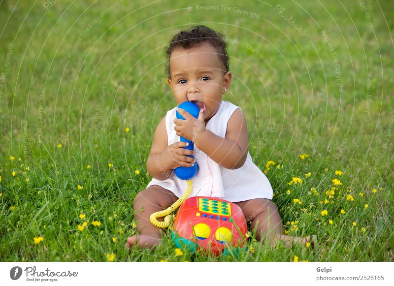 Adorable little black girl with big phone Child Nature Beautiful Colour Green Flower Black Environment Natural Meadow Grass Garden Playing Freedom Fresh Baby