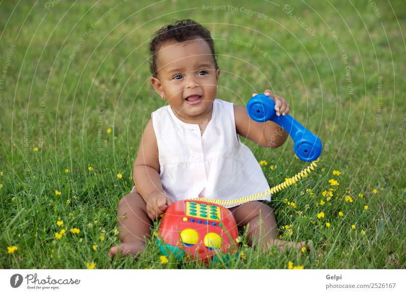 Adorable little black girl with big phone Herbs and spices Beautiful Playing Freedom Garden Child Telephone Baby Toddler Environment Nature Flower Grass Meadow