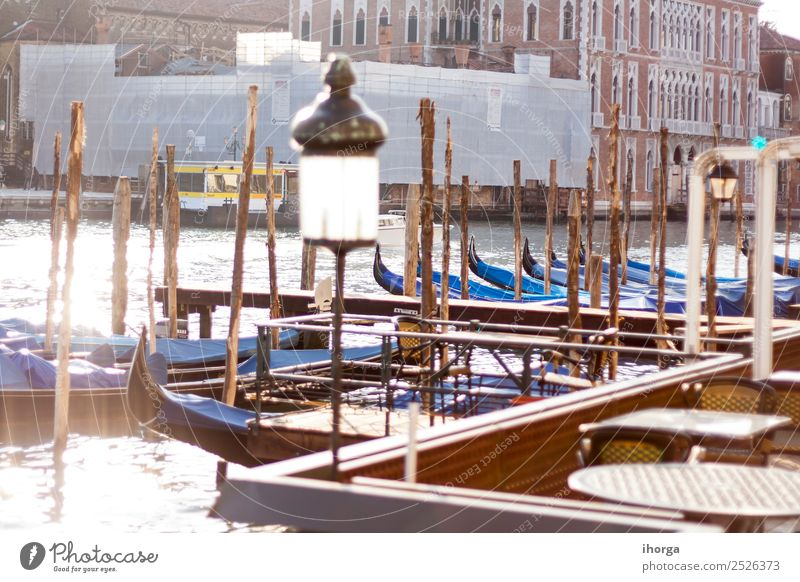 gondolas moored in the canals of Venice Elegant Beautiful Vacation & Travel Tourism Trip Harbour Bridge Building Architecture Transport Watercraft Old Historic