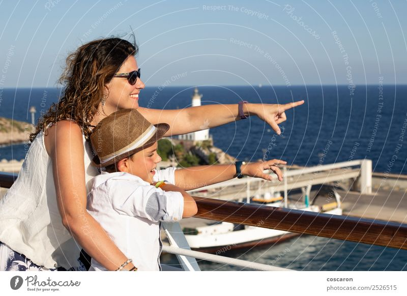 Mother and son pointing a place near the sea Woman Child Nature Vacation & Travel Summer Blue Beautiful Ocean Beach Adults Lifestyle Family & Relations Happy