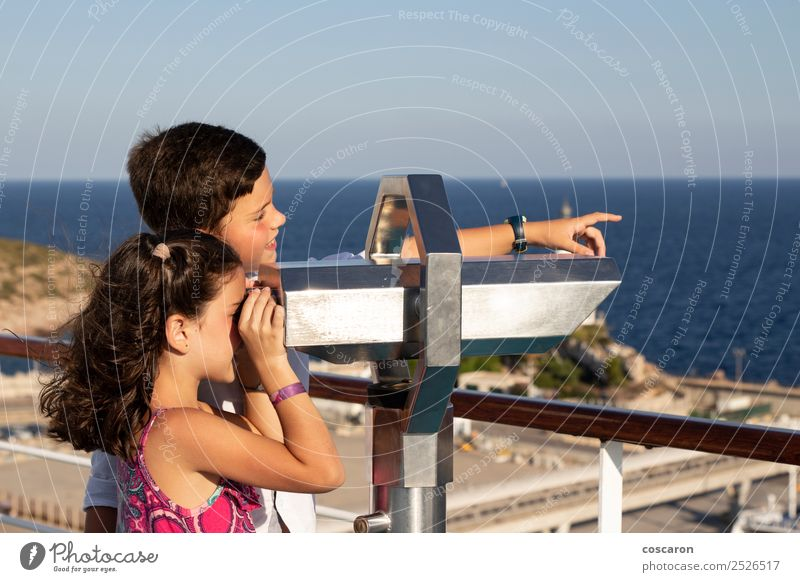 Boy and girl using a binoculars outdoors Joy Beautiful Leisure and hobbies Tourism Adventure Safari Ocean Child Boy (child) Woman Adults Man Sister Friendship