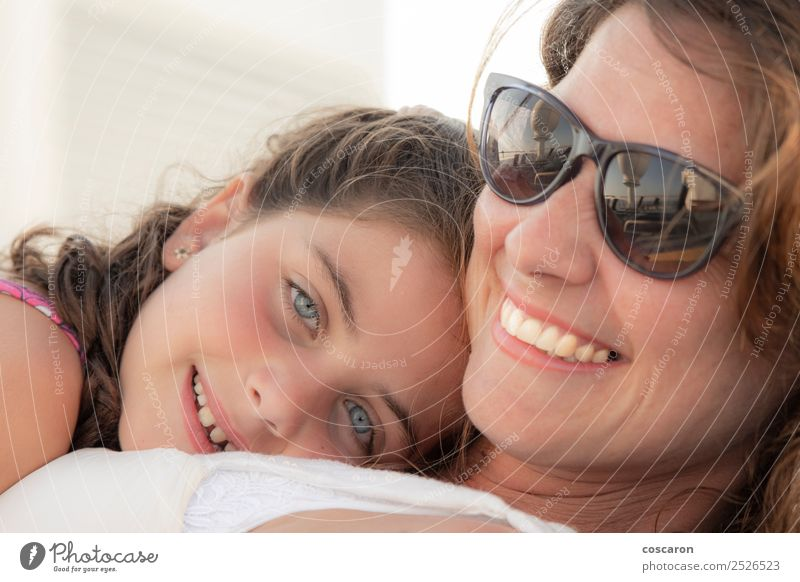 Mother and daughter smiling and hugging outdoors Woman Child Human being Nature Summer Beautiful White Joy Girl Adults Love Feminine Family & Relations Laughter