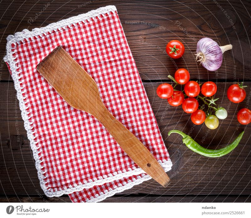 wooden spatula on a red textile towel Vegetable Herbs and spices Nutrition Vegetarian diet Diet Spoon Kitchen Wood Eating Fresh Small Above Juicy Green Red