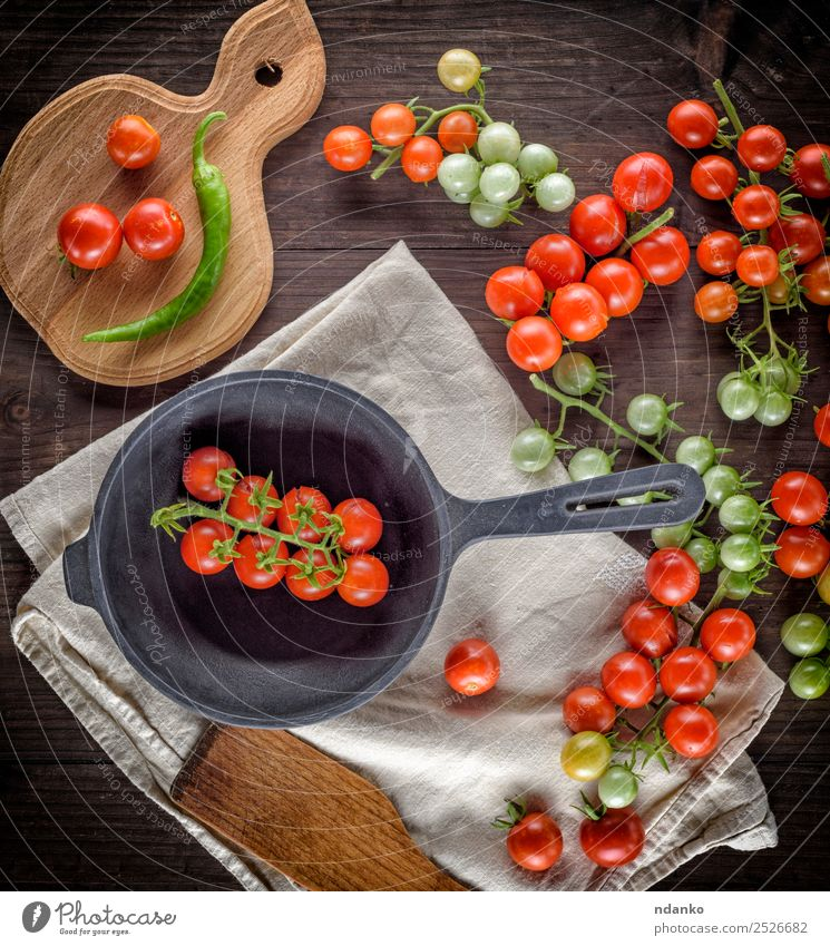 frying pan and ripe red cherry tomatoes Green Red Black Eating Natural Wood Small Copy Space Above Fresh Kitchen Vegetable Mature Vegetarian diet Tomato Salad
