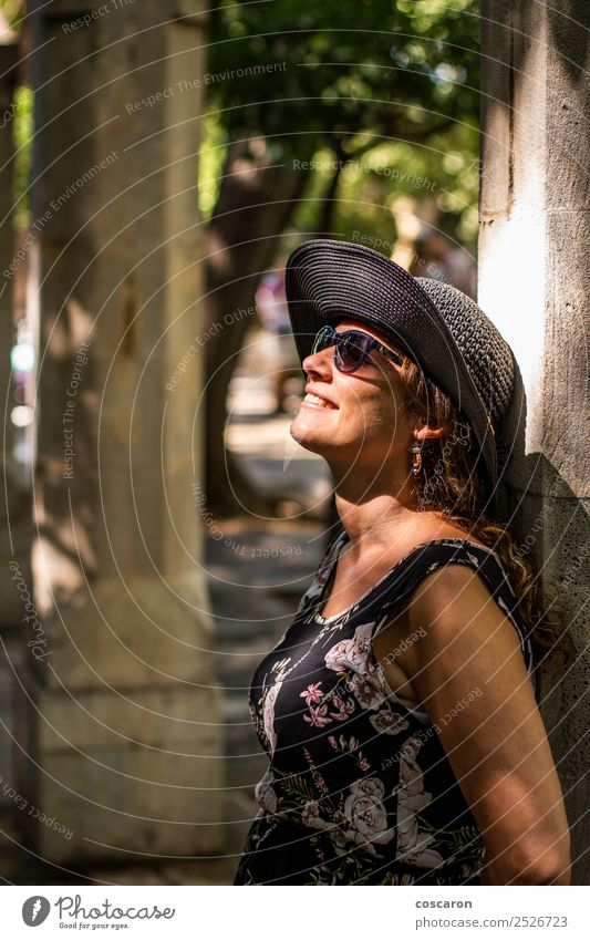 Woman leaning against a column with sunbeams on her face Human being Vacation & Travel Summer Beautiful Sun White Tree Black Face Adults Lifestyle Feminine