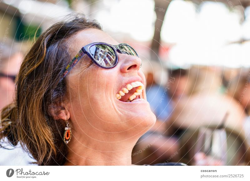 Portrait of a middle aged woman laughing Lifestyle Joy Happy Beautiful Face Summer Winter Human being Feminine Woman Adults 1 30 - 45 years Nature Park