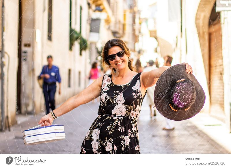 Woman shopping on the streets of Palma, Majorca, Spain. Lifestyle Shopping Joy Happy Beautiful Relaxation Vacation & Travel Tourism Human being Feminine Adults
