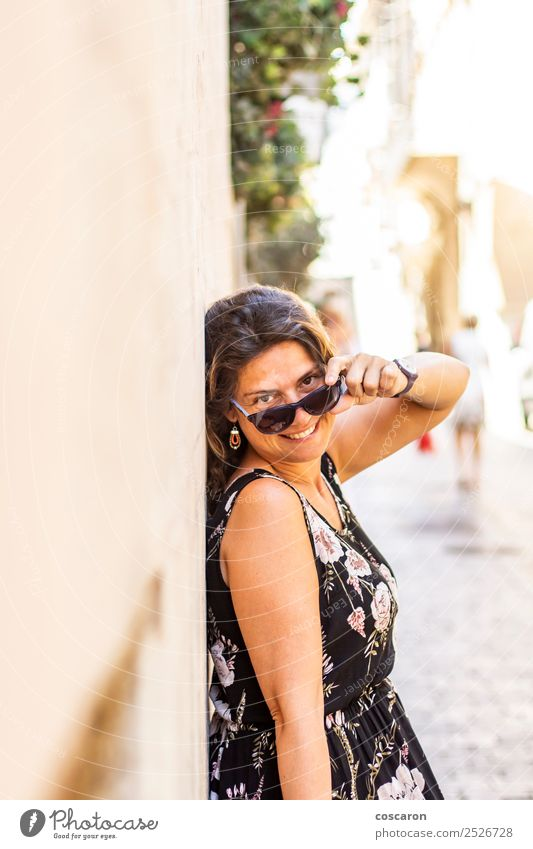 Middle aged woman on the streetwith a sunglasses Woman Human being Vacation & Travel Summer Beautiful White Joy Black Face Street Adults Lifestyle Feminine