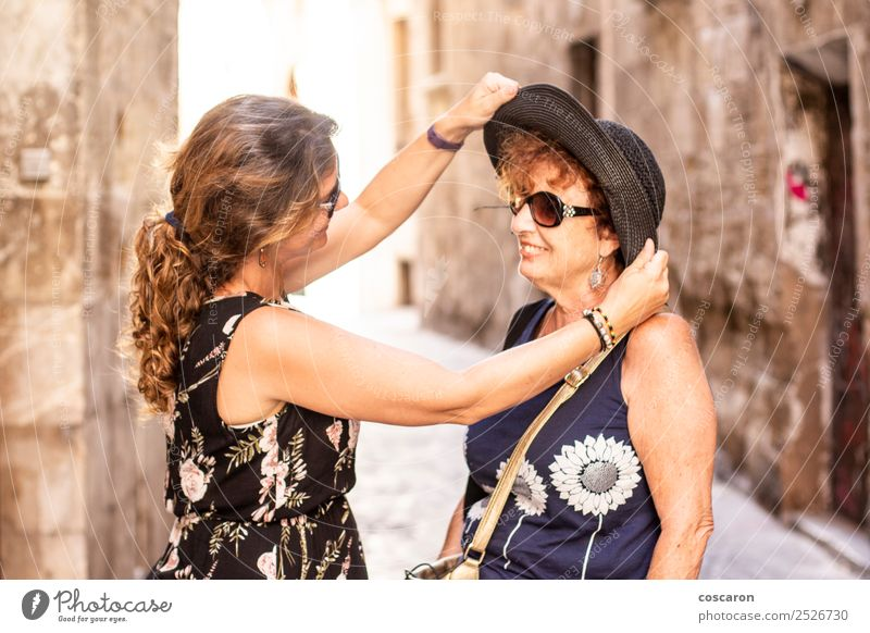 Mother and daughter on the street at summer Woman Human being Vacation & Travel Old Town Beautiful Joy Street Adults Lifestyle Love Senior citizen Feminine