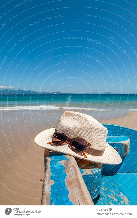 Hat on the beach Nature Vacation & Travel Landscape Ocean Relaxation Beach Emotions Coast Sports Tourism Sand Watercraft Adventure Cool (slang) Turquoise