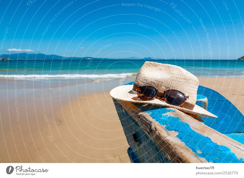 Heat and boat on the beach Vacation & Travel Ocean Relaxation Beach Coast Sports Tourism Sand Watercraft Hat Sunglasses Blue sky Scarf Slippers