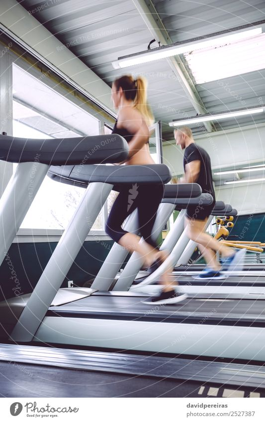 People in motion during a treadmill training Lifestyle Leisure and hobbies Sports Jogging Human being Woman Adults Man Friendship Sneakers Movement Fitness