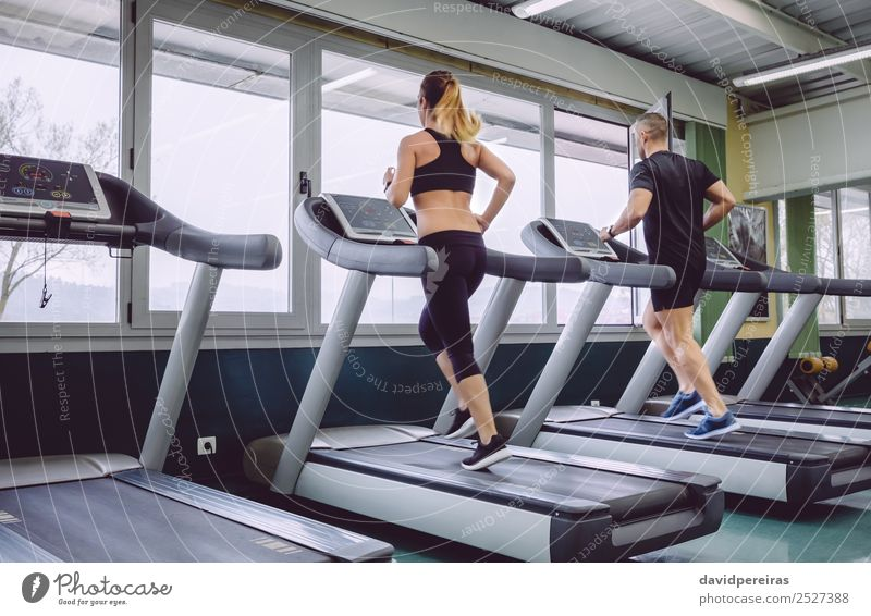 People running over treadmill in a training session Lifestyle Leisure and hobbies Sports Jogging Human being Woman Adults Man Friendship Sneakers Movement