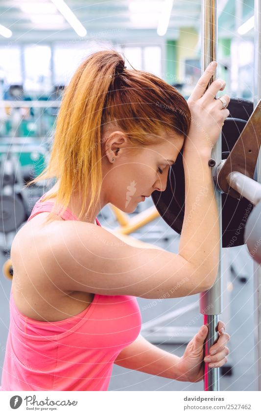 Woman resting tired after lifting barbell on muscular training Lifestyle Beautiful Body Sports Human being Adults Arm Fitness Authentic Thin Eroticism Muscular