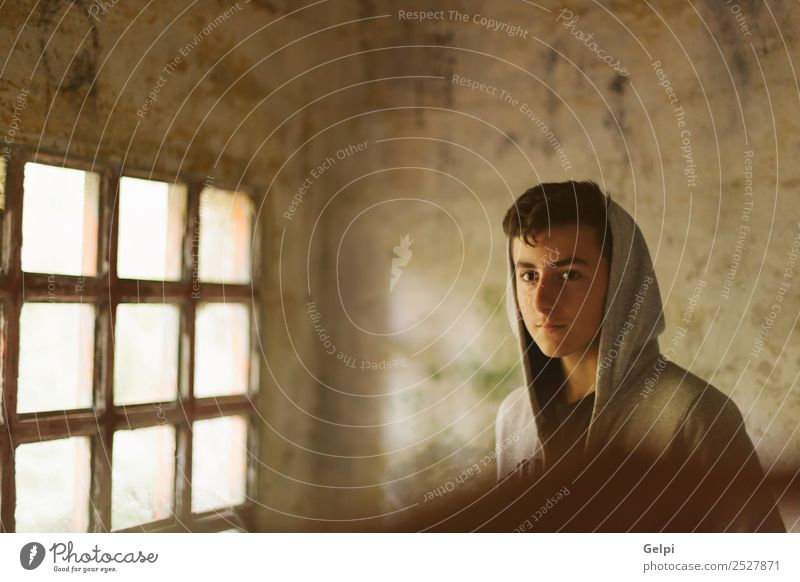 Hooded teenage boy in an abandoned house illuminated by a window Lifestyle Face Child Human being Boy (child) Man Adults Youth (Young adults) Street Fashion