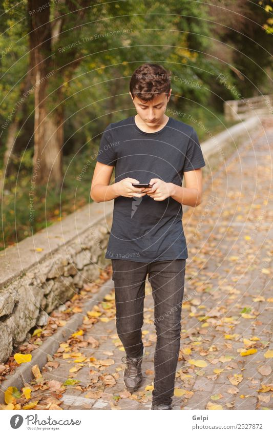 Cool teenager with fifty years old and a mobile on the street Lifestyle Happy Reading Telephone Cellphone PDA Technology Internet Human being Boy (child) Man