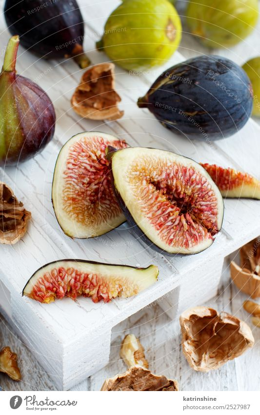 Fresh purple and green figs Fruit Dessert Vegetarian diet Diet Exotic Summer Autumn Wood Delicious White Fig food Organic Purple Mature seed Slice sweet Vitamin