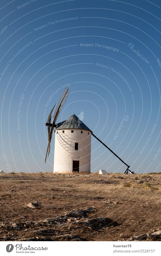 A typical Spanish windmill Vacation & Travel Wind Hill Village Building Architecture Tourist Attraction Monument Lanes & trails Old Historic Blue Windmill