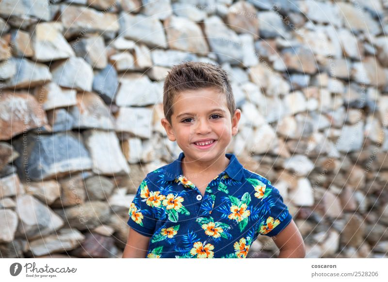 Portrait of a cute little boy against of a stone wall Style Happy Beautiful Face Summer Child Camera Human being Baby Toddler Boy (child) Man Adults Infancy 1