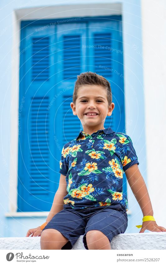 Portrait of a cute little boy on a village of an island greek Lifestyle Vacation & Travel Tourism Summer Island House (Residential Structure) Child Toddler