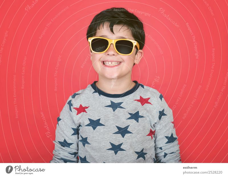smiling boy with yellow sunglasses Child Human being Vacation & Travel Summer Sun Joy Lifestyle Funny Emotions Happy Boy (child) Freedom Masculine Infancy